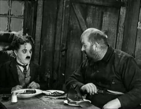 Charlie Chaplin eating his shoe - The Gold Rush (High Quality)