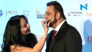 Love everywhere! Manyata Dutt grooms Sanjay Dutt on red carpet