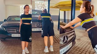 Neha Kakkar doing Pregnancy Workout To Lose Belly Fat. doing push-ups against her Mercedes