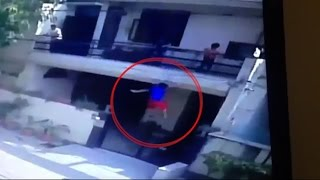 On Cam - Boy falls from balcony while hurling water-balloons News Video