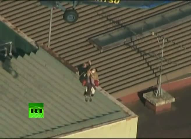 Rooftop helicopter rescue in Japan's tsunami-hit town