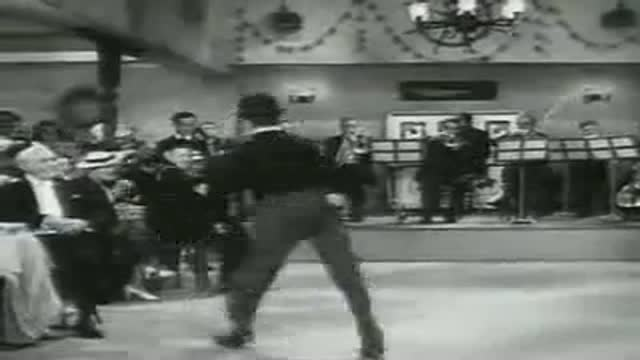 Charlie Chaplin dancing and singing
