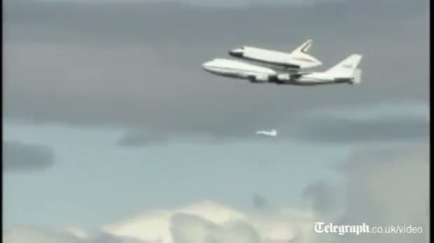 Space shuttle in Statue of Liberty flypast