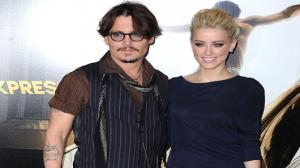 Johnny Depp buys 'new love' bi$exual actress Amber Heard a horse and gives ex-partner Vanessa Paradis $125 million