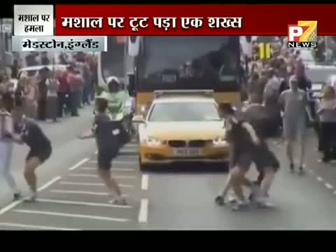 Man tries to Grab Olympic Torch off a Woman Runner in Gravesen