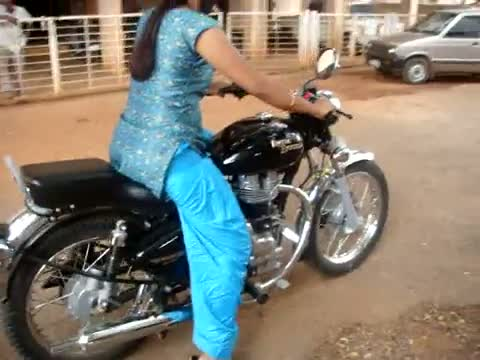 My Sister hand starting her Enfield Bullet and taking a ride..