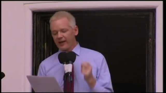 Julian Assange Speaks to Media Outside Embassy Video