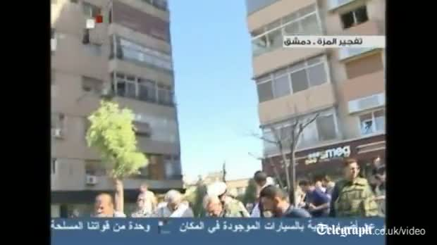 Syrian state TV shows aftermath of Damascus car bomb