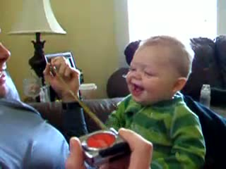 Baby laughing at a tape measure