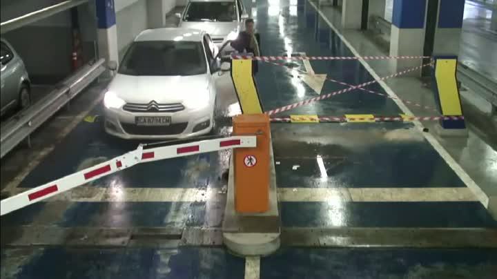Woman Driver Vs. Parking Barrier