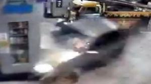Car Crashes Into Gas Pumps