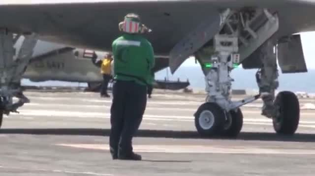 Navy Launches Drone From Aircraft Carrier