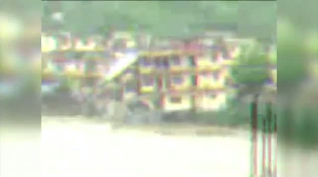 India Floods Wash Away Apartment Building