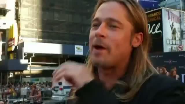 Brad Pitt shows fans the love at World War Z premiere