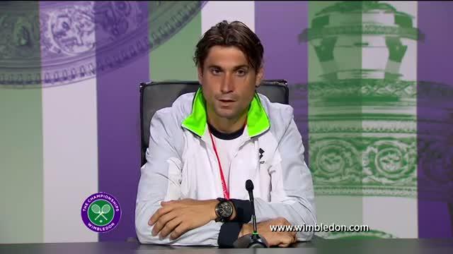 David Ferrer reacts to quarter-final defeat at Wimbledon 2013