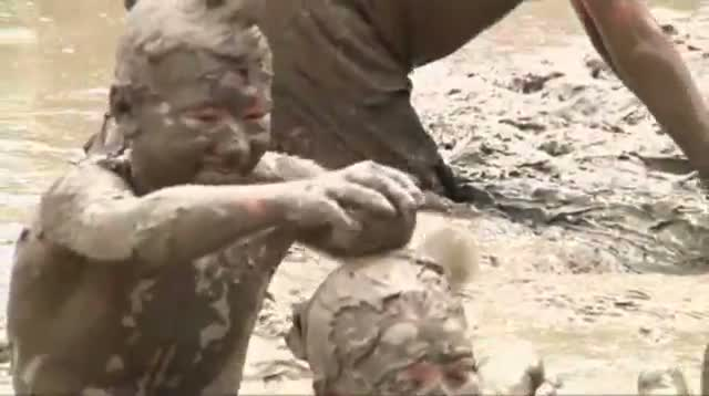 Kids Get Down and Dirty at Mud Day in Michigan