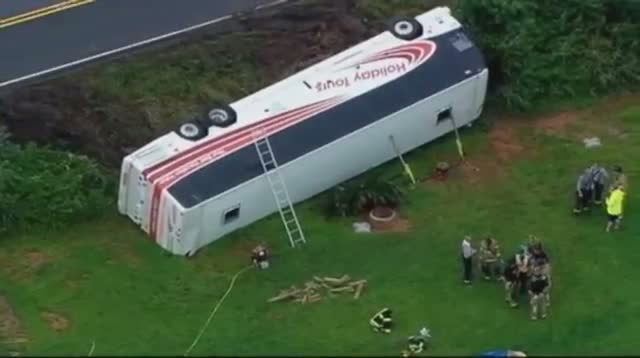 Raw: Bus Carrying Army Reservists overturns