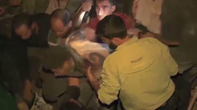 Neighbors Rush to Aid Trapped Syrian Family