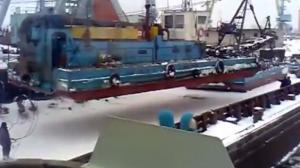 Huge Crane Lowering A Boat Collapses