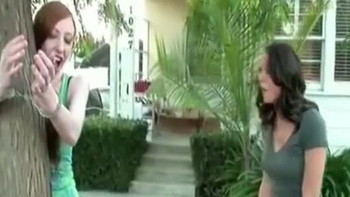 Girl Handcuffed to tree gets pants pulled down
