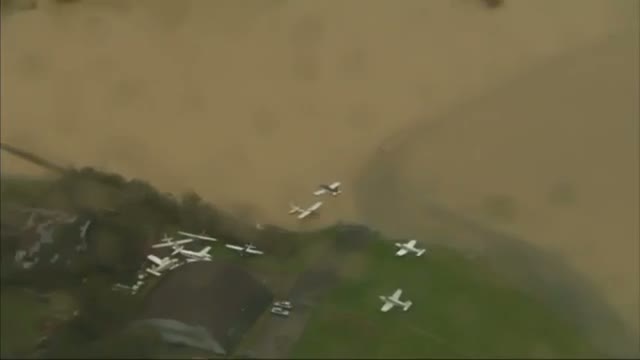 Planes underwater in Surrey: Helicopter aerials show extreme flooding in southern England