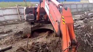 Construction Worker Lights His Cigarette With An Excavator