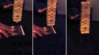 Guy Successfully Removes Last Bottom Jenga Piece Without Collapsing Tower