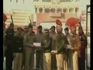 India, Pakistan Army Soldiers Exchange Sweets at Wagah Border on 65th Republic Day 2014 Video