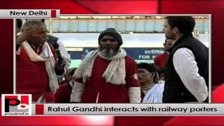 Rahul Gandhi interacts with railway porters