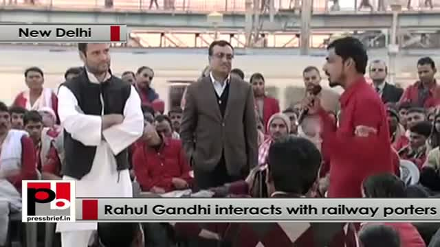 Rahul Gandhi interacts with railway porters in New Delhi Railway Station
