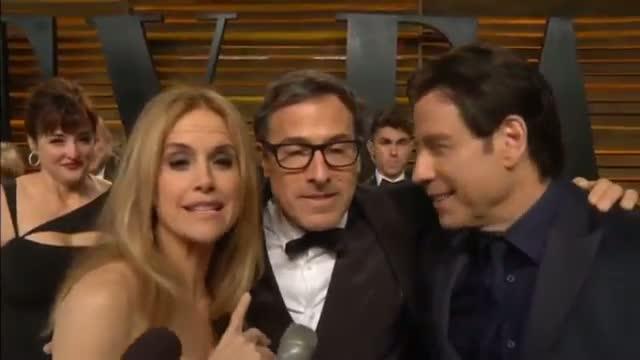 AWKWARD: Orlando Bloom interrupts Miranda Kerr's interview at Vanity Fair Oscars party