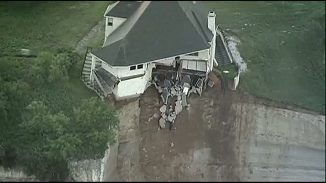 House Teeters on Edge of 75-foot Cliff