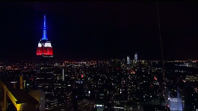Empire State Lit Up Red, White and Blue