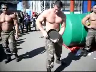 Strong Russian guy doing impossible things