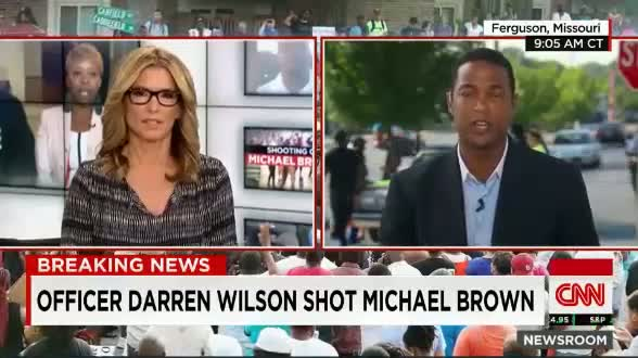 Michael Brown shot by Black officer Darren Wilson Mike Brown Robbed store in photo Ferguson Protest