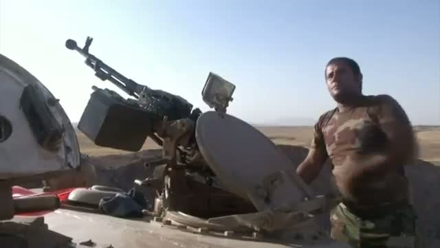 Kurdish Forces, IS Militants Clash in Iraq