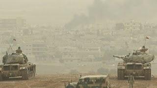 Raw: Gunfire Over Kobani, Turkey Stands Guard