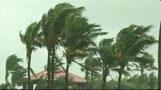 Cyclone Hudhud loses speed as it crosses Andhra Pradesh