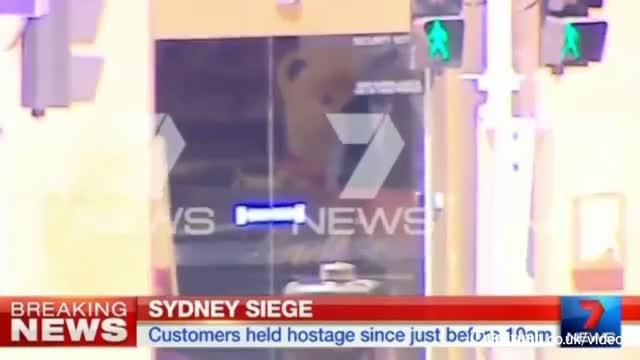 Sydney siege: 'Islamist gunman' holds hostages inside cafe video