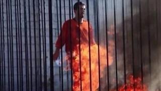 Jordanian pilot Burned in a cage Muaz Kassasbe: ISIS release AGAIN video