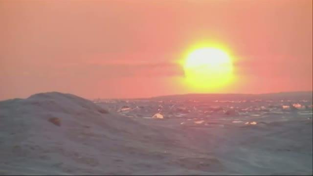 Sunrise Over Frozen Lake Superior