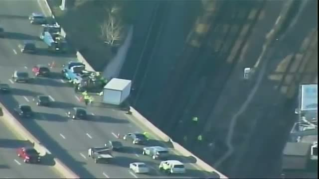 Truck Hangs Off Boston Highway Bridge