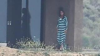 Bruce Jenner seen wearing striped dress outside Malibu home