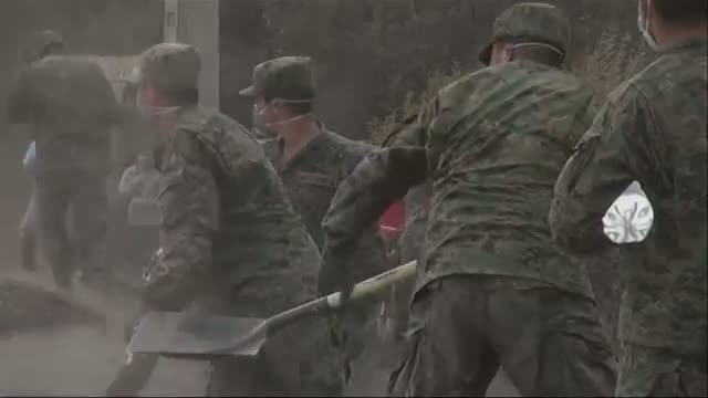 Soldiers Clear Ash From Chile Volcano