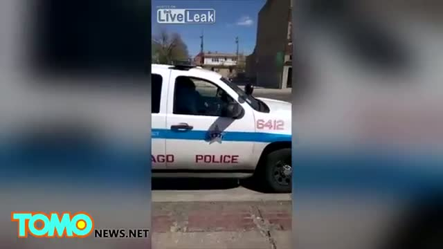 Caught on video: Chicago cops asleep inside his police car