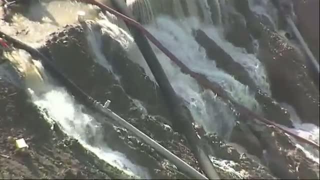 Water Flows Over Texas Dam