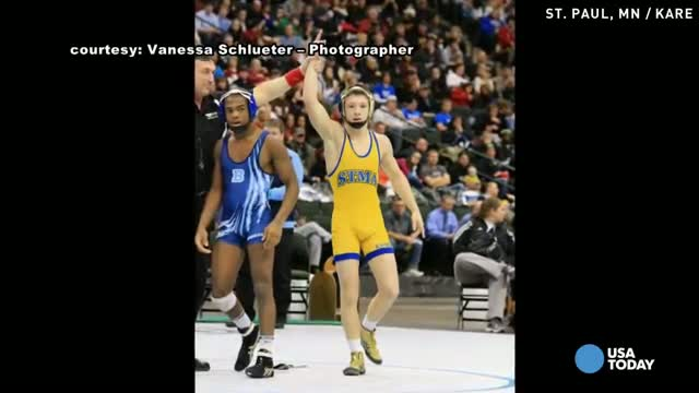 Losing wrestler's sportsmanship wows crowd