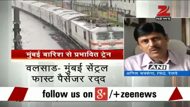 Mumbai rail services disrupted in view of heavy rains - News Video