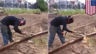 Man vs train tracks: Rail worker cutting through train tracks is about to experience pain