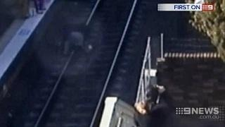 Grandfather leaps onto train tracks to save baby girl